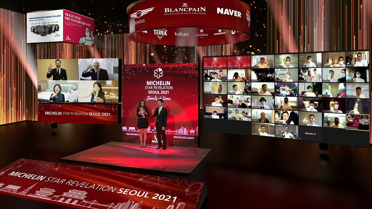 Participants of Michelin Guide Seoul's online star revelation ceremony hoist Champagne glasses toward the screen on Thursday. (Michelin)