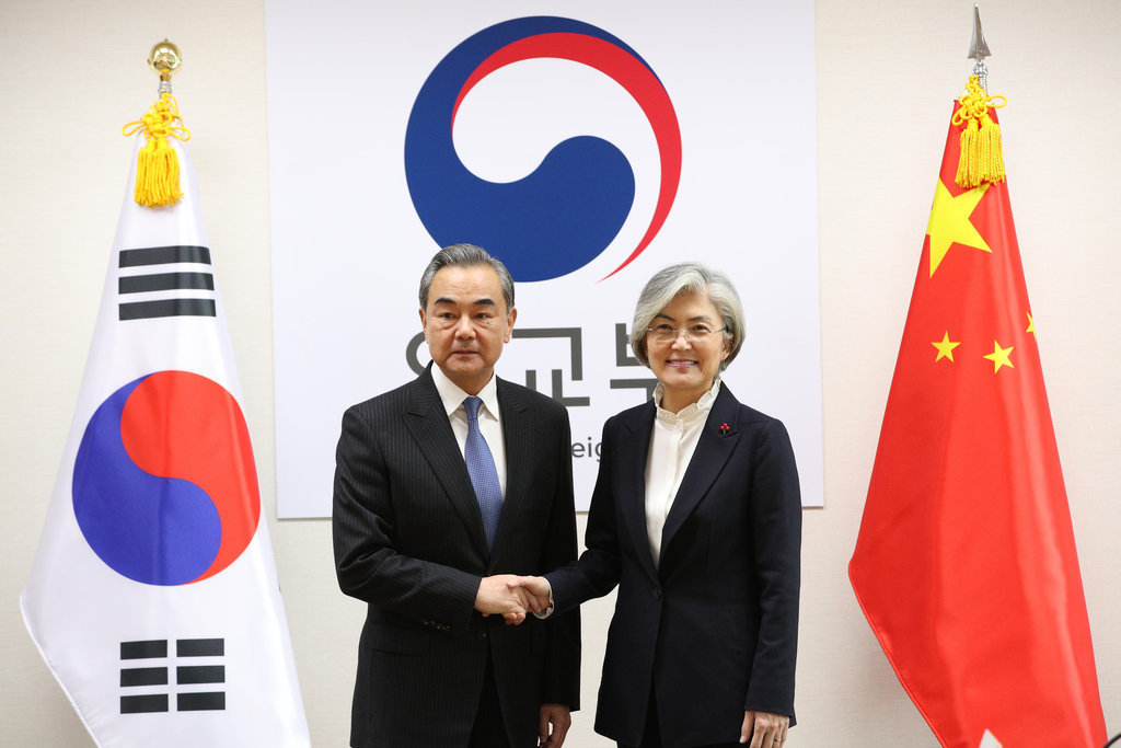 South Korean Foreign Minister Kang Kyung-wha (R) shakes hands with her Chinese counterpart Wang Yi ahead of their meeting in Seoul on Dec. 4, 2019. Wang flew into Seoul earlier in the day, his first trip here since bilateral ties soured in 2016 over the installation of a US missile defense system in South Korea. (Yonhap)