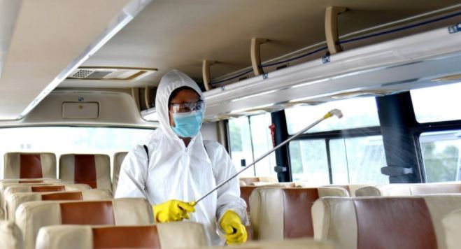 An official disinfects a bus in Pyongyang amid the coronavirus pandemic, in this undated photo released by the North's official Korean Central News Agency on Sept. 4. (KCNA-Yonhap)