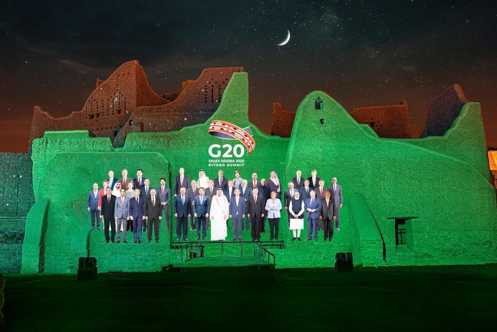 A family photo for annual G-20 leaders is projected onto Salwa Palace in At-Turaif, one of Saudi Arabia's UNESCO World Heritage sites, in Diriyah on Friday. (Diriyah Gate Development Authority of Saudi)
