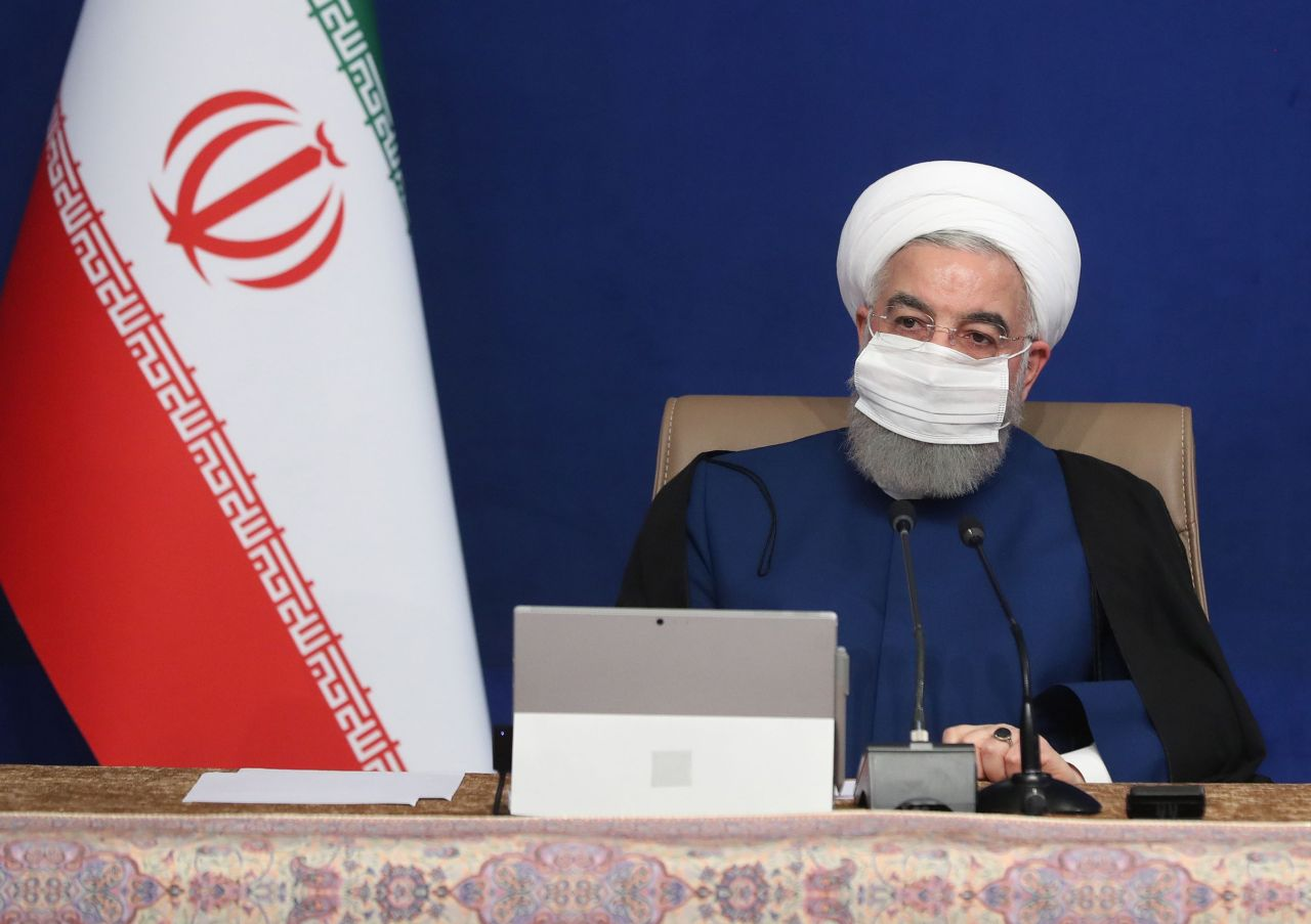 A handout picture provided by the Iranian presidency shows President Hassan Rouhani wearing a protective mask due to the COVID-19 coronavirus pandemic while chairing a cabinet meeting in the capital Tehran on November 11. (AFP-Yonhap)