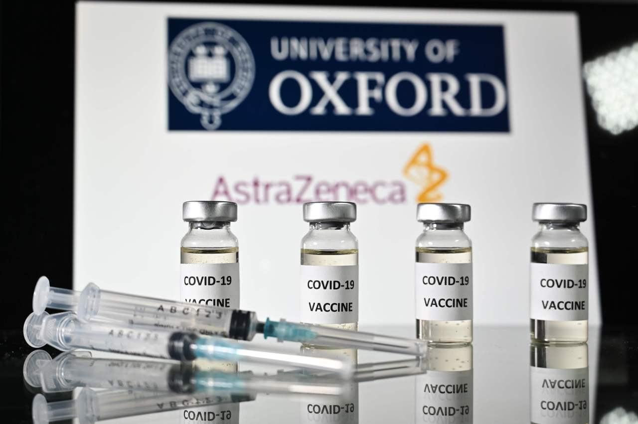 An illustration picture shows vials with Covid-19 Vaccine stickers attached and syringes, with the logo of the University of Oxford and its partner British pharmaceutical company AstraZeneca, on November 17, 2020. (AFP-Yonhap)