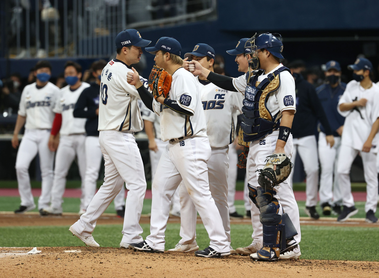 The NC Dinos' players celebrate after winning Game 5 of the Korean Series at Gocheok Sky Dome in Seoul on Monday. (Yonhap)