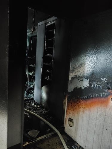 This photo, provided by the Busan Metropolitan Police Agency, shows the scene of a fire that broke out at an apartment building in the southeastern port city of Busan on Monday. (Busan Metropolitan Police Agency)