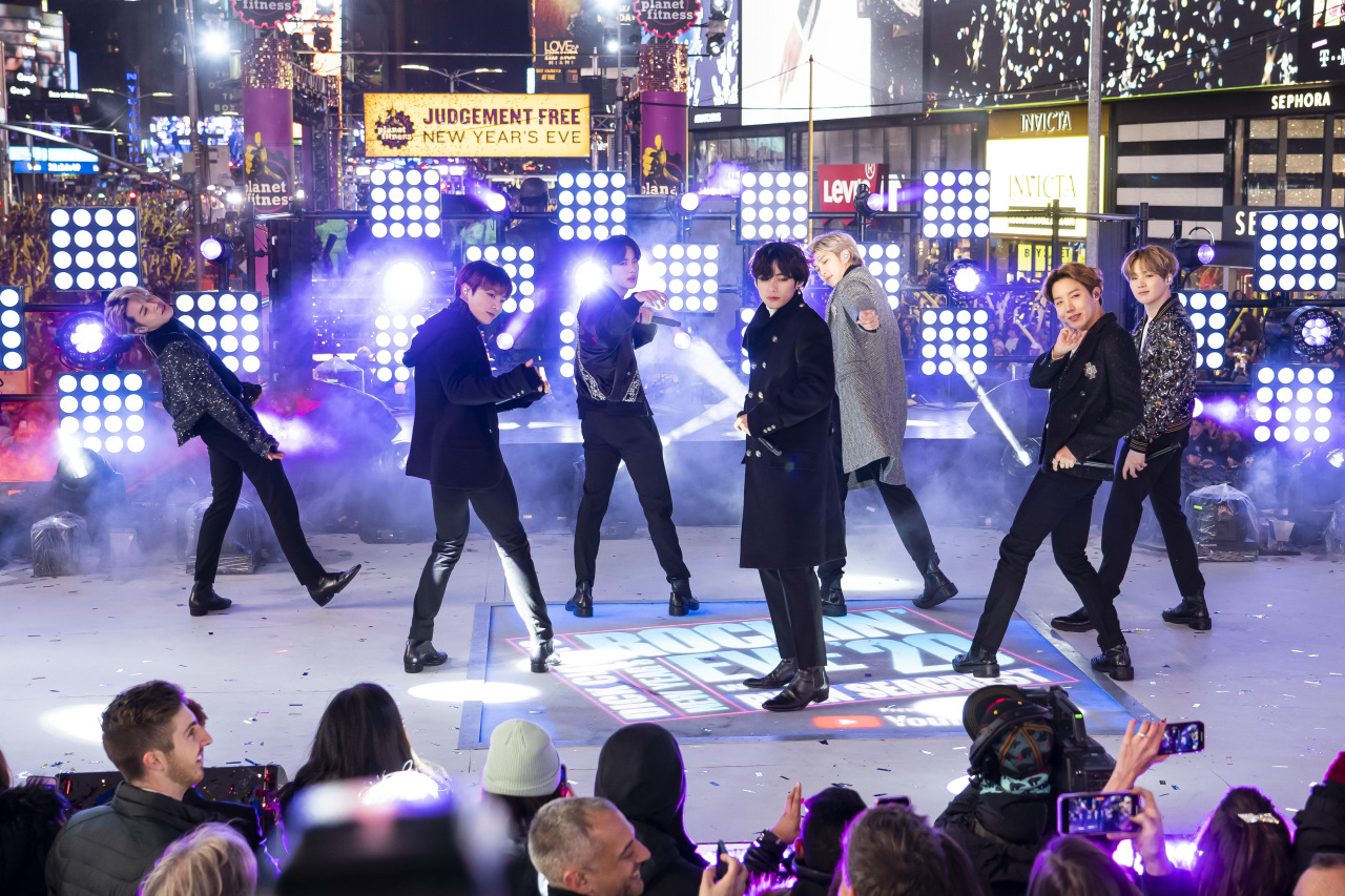 Members of BTS perform at the Times Square New Year's Eve celebration in New York on Dec. 31, 2019. (AP-Yonhap)