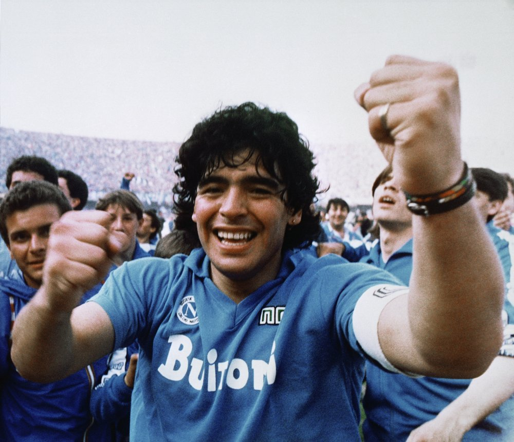 Argentine soccer superstar Diego Armando Maradona cheers after the Napoli team clinched its first Italian major league title in Naples, Italy, on May 10, 1987. Diego Maradona has died. The Argentine soccer great was among the best players ever and who led his country to the 1986 World Cup title before later struggling with cocaine use and obesity. He was 60. (AP-Yonhap)