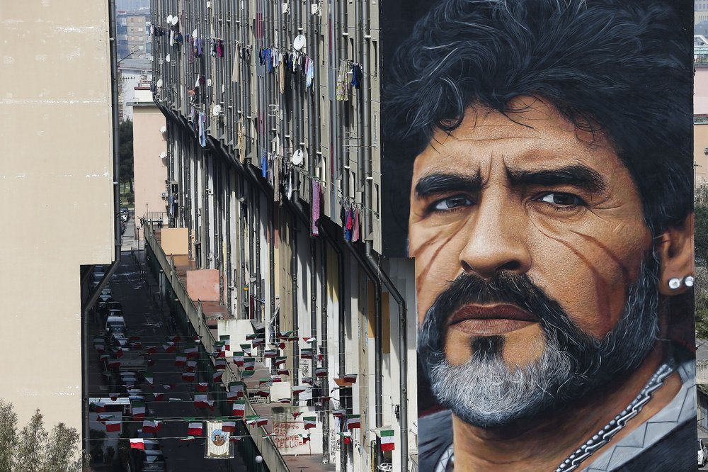 A mural depicting Diego Maradona, by street artist Jorit, is painted on a building in Naples, Italy, March 24, 2017. Diego Maradona has died. The Argentine soccer great was among the best players ever and who led his country to the 1986 World Cup title before later struggling with cocaine use and obesity. He was 60. (AP-Yonhap)