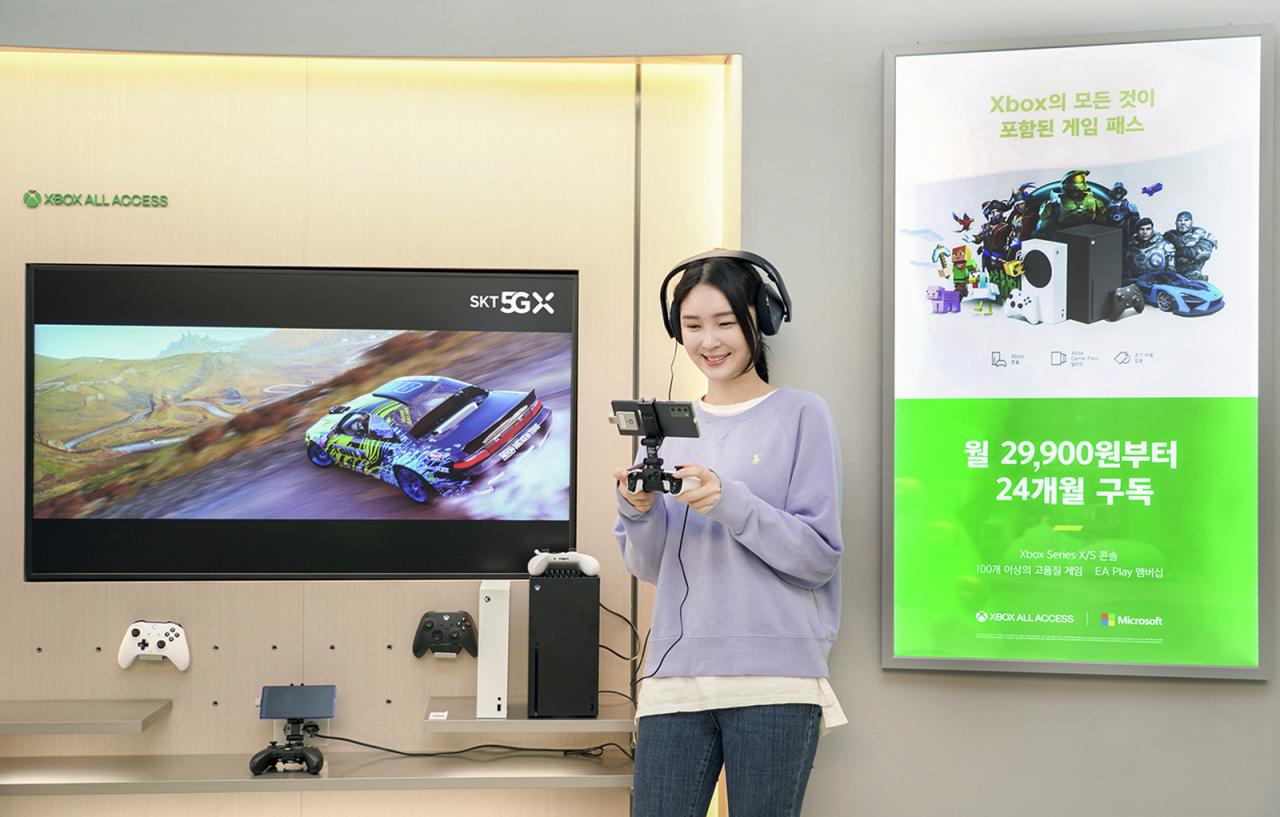 A model plays a game using SK Telecom Co.'s 5GX Cloud Game service (SK Telecom Co.)