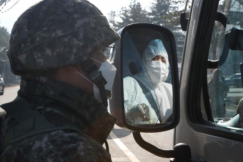 A worker enters an Army boot camp in Yeoncheon, Gyeonggi Province, on Thursday, to transport COVID-19 patients among the unit members. (Yonhap)