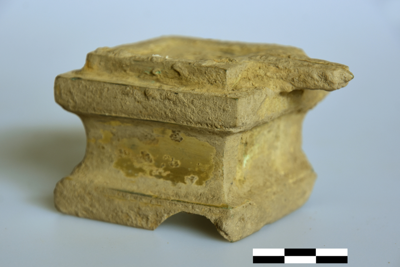 A gilt-bronze yoni that was excavated in February 2019 as part of the Korea Cultural Heritage Foundation's ODA project (Korea Cultural Heritage Foundation)