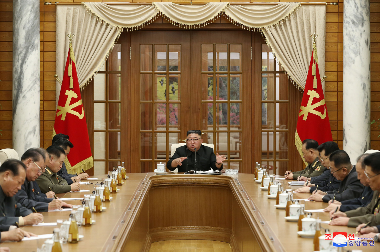 North Korean leader Kim Jong-un (C) presides over a politburo meeting of the Workers' Party and discusses preparation for an upcoming rare party meeting on Monday. (KCNA-Yonhap)