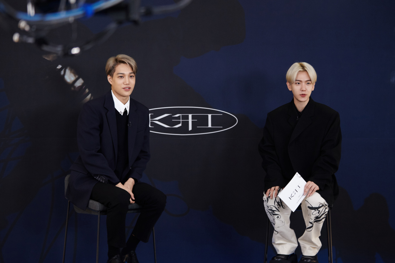 Kai (left) and Baekhyun, both members of EXO, speak during Kai's solo debut press conference in Seoul on Monday. (S.M. Entertainment)