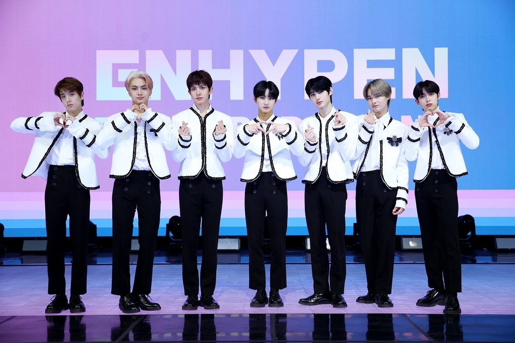 Members of rookie boy band ENHYPEN posing for a photo during a media showcase held online on Monday. (Belift Lab)
