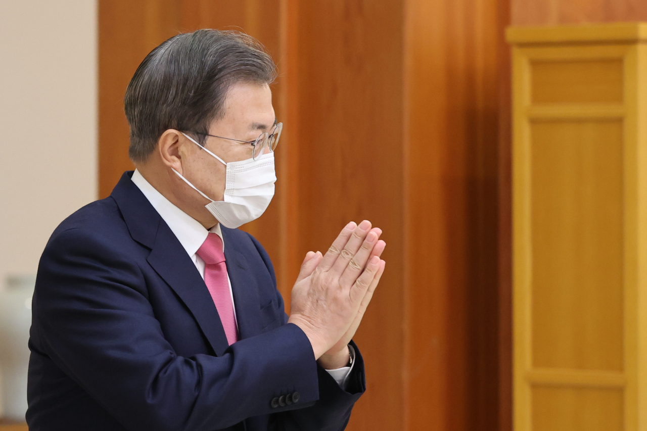 President Moon Jae-in puts his hands together during a Cheong Wa Dae ceremony in Seoul to give newly appointed ambassadors letters of appointment on Wednesday. (Yonhap)
