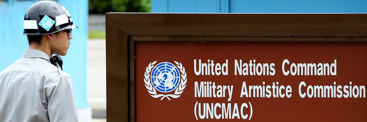 A soldier standing guard in front of the office of the United Nations Command's (UNC) Military Armistice Commission at the inter-Korean truce village of Panmunjom. (Yonhap)