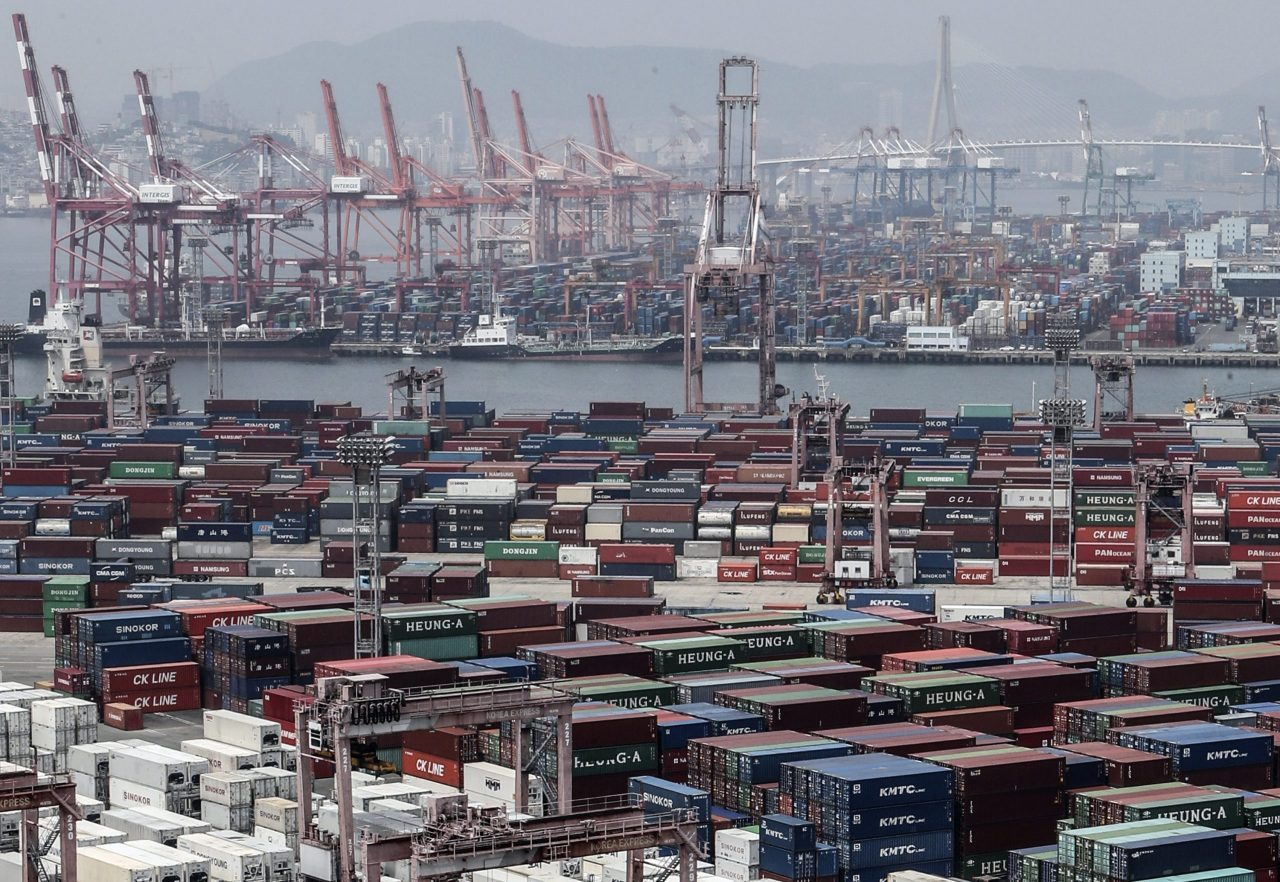 This file photo, taken June 4, shows stacks of import-export cargo containers at South Korea's largest seaport in Busan, 450 kilometers southeast of Seoul. (Yonhap)
