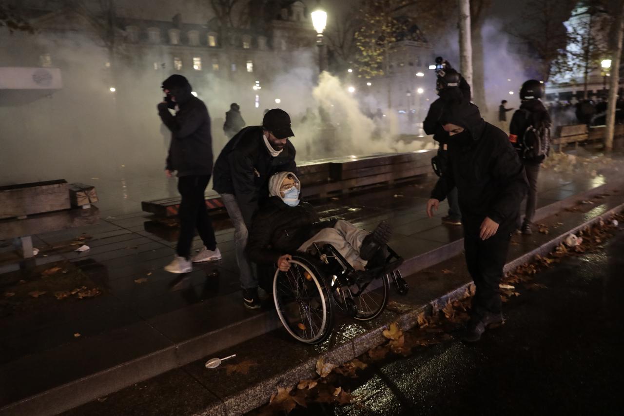 Demonstrators leave the Place de la Republique among tear gas after a demonstration, Saturday, in Paris. (AP-Yonhap)