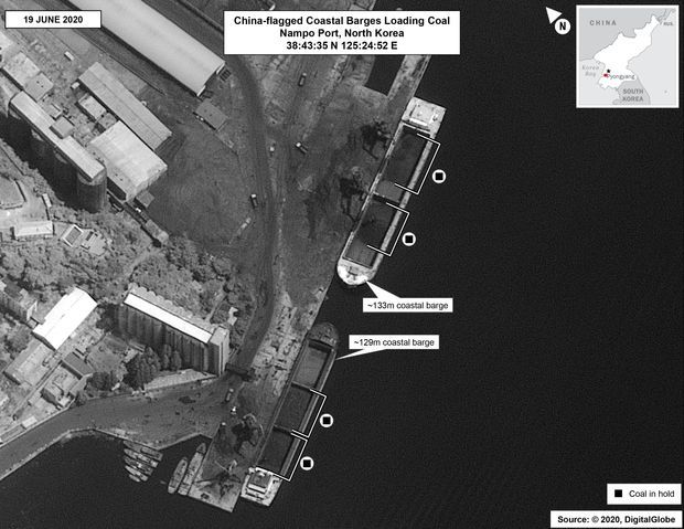 This satellite photo shows a Chinese-flagged barge loading coal at North Korea's Nampo port on June 19. (US Government)