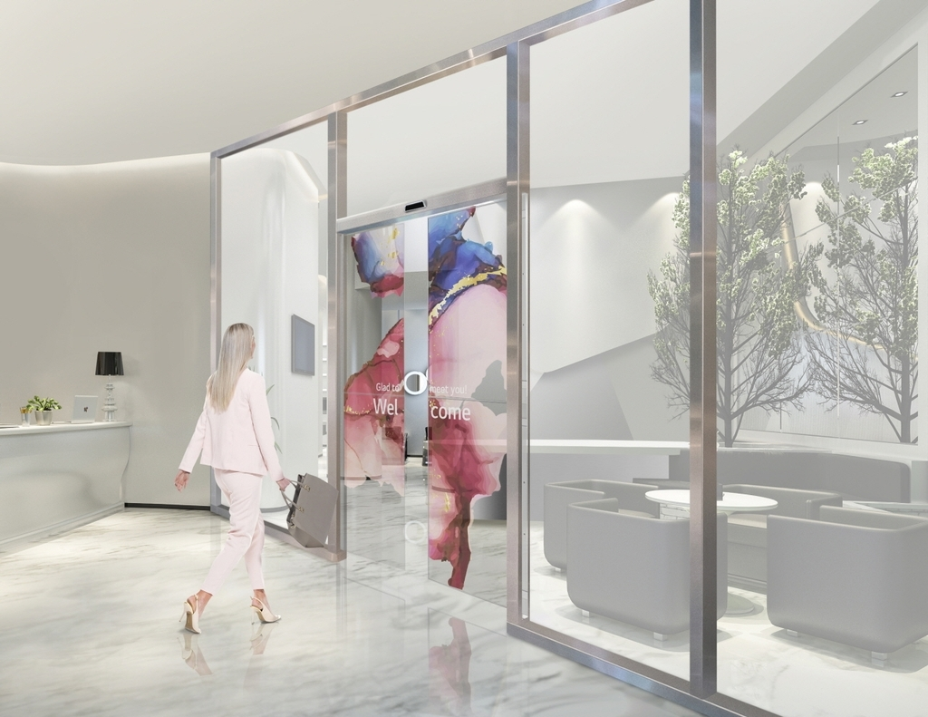This image provided by LG Electronics Inc. on Wednesday, shows automatic sliding doors using the company's transparent OLED displays. (LG Electronics Inc.)