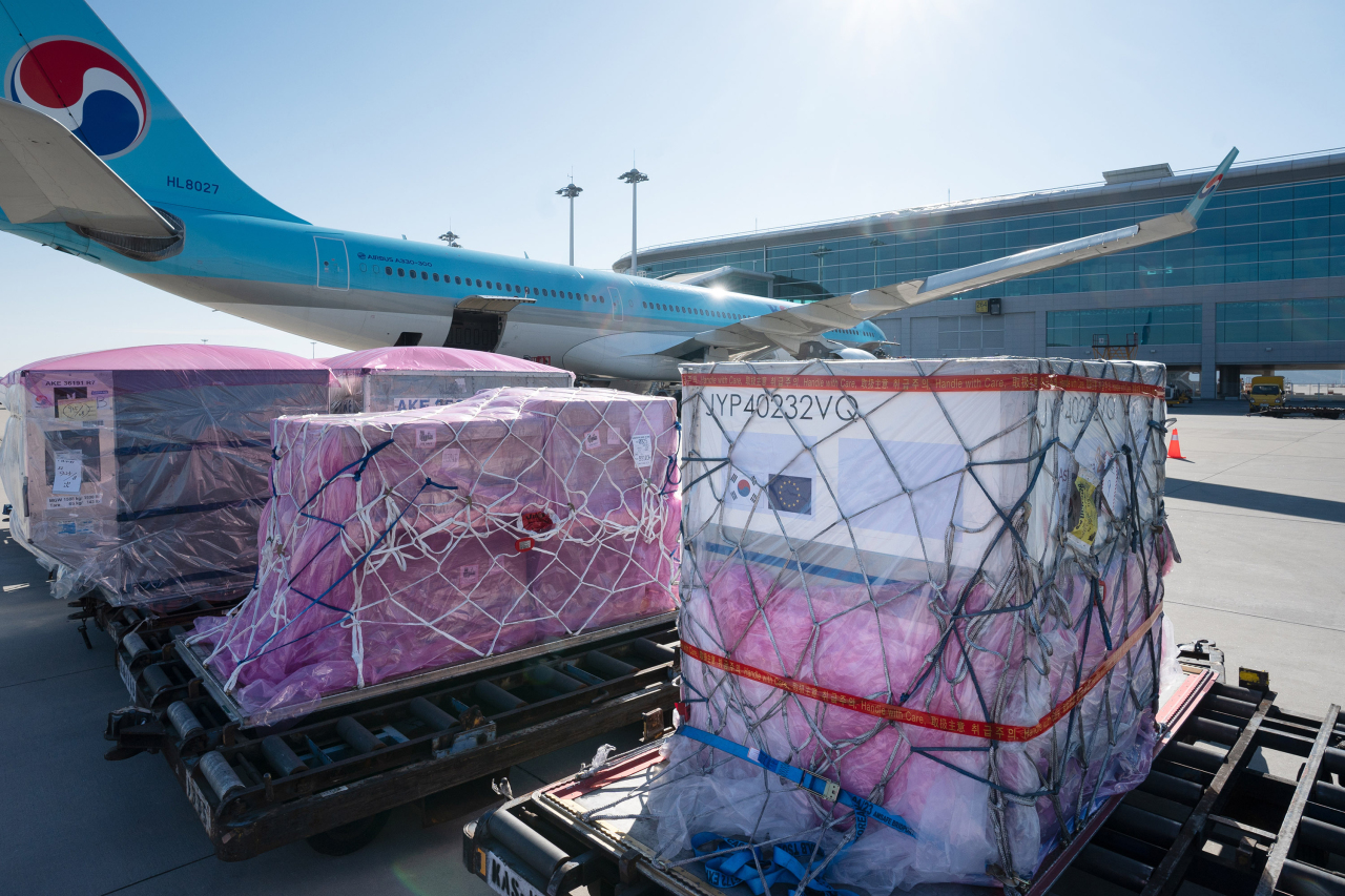 Packages containing COVID-19 vaccine raw materials are loaded on Korean Air's KE925 flight from Incheon to Amsterdam on Tuesday. (Korean Air)