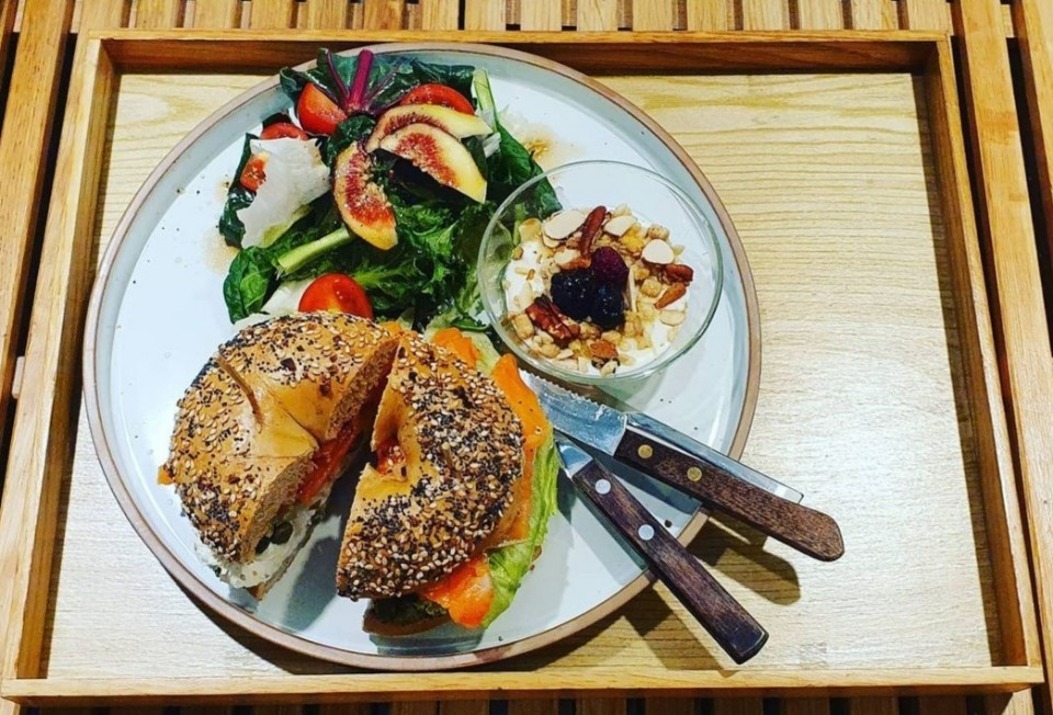 Lots O Bagels' variation of the classic lox and schmear features smoked salmon in lieu of lox, in-house cream cheese, iceberg lettuce, tomato, onion and capers. (Photo credit: New York Lots O Bagels)
