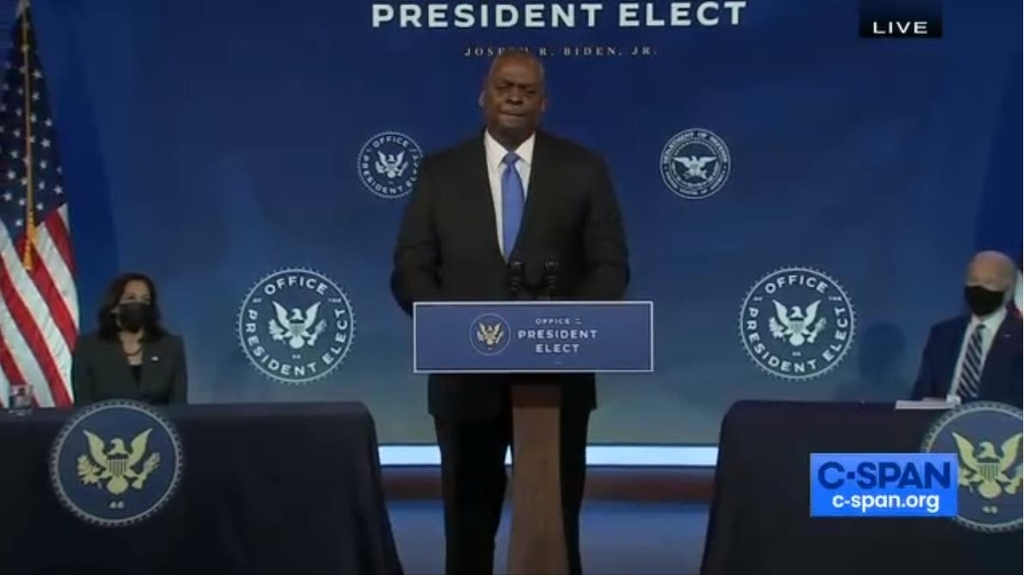 The captured image from the website of US cable news network C-Span shows Gen. Lloyd Austin (retired, at podium) speaking at a press conference in Wilmington, Delaware, on Wednesday, where he was formally tapped by President-elect Joe Biden (R) as next secretary of defense. (C-Span website)