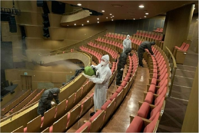 Workers disinfect an auditorium at the Seoul Arts Center. (SAC)