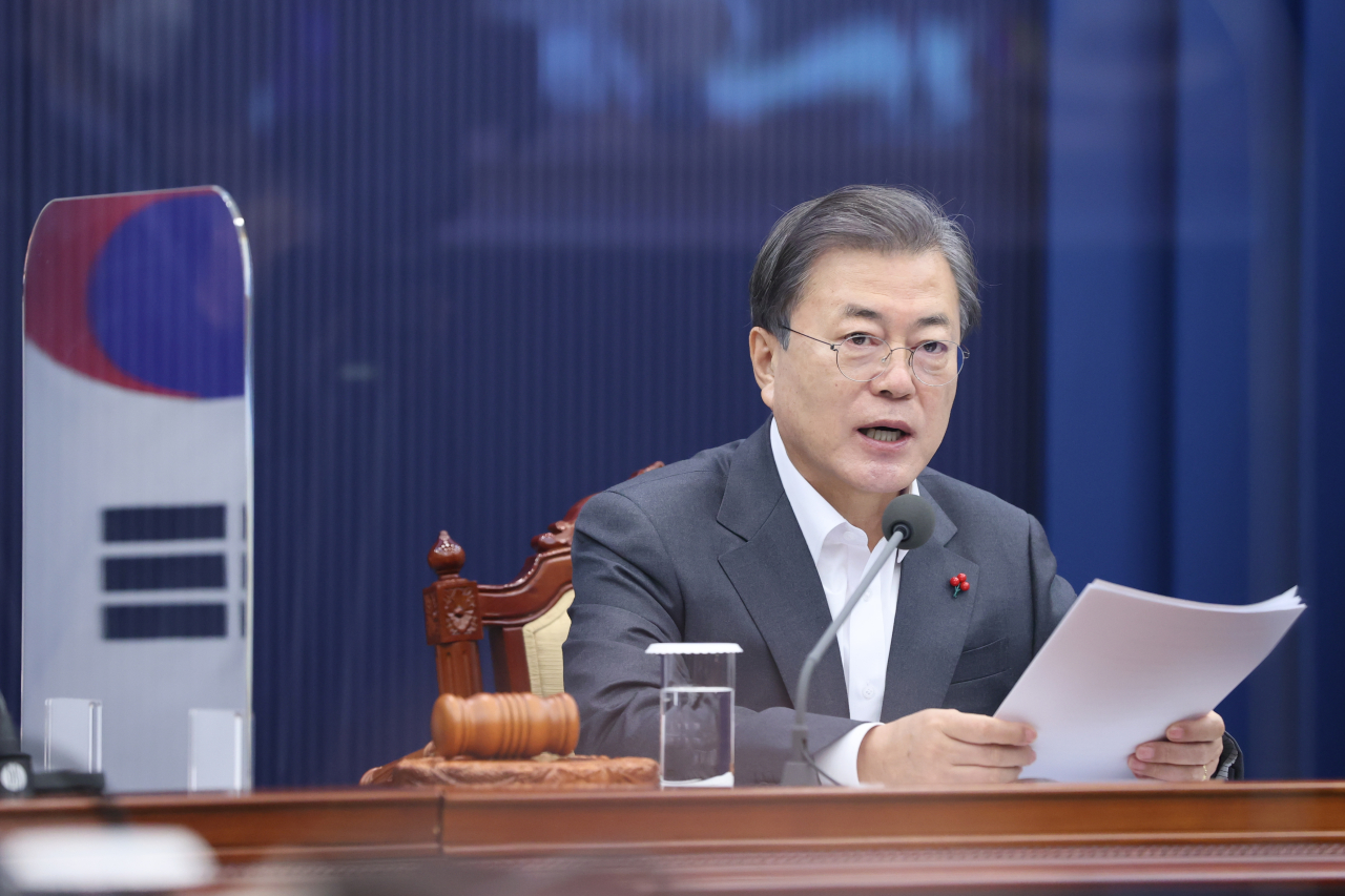 President Moon Jae-in speaks via videoconference during a Cabinet meeting at the presidential office Cheong Wa Dae in Seoul on Tuesday. (Yonhap)
