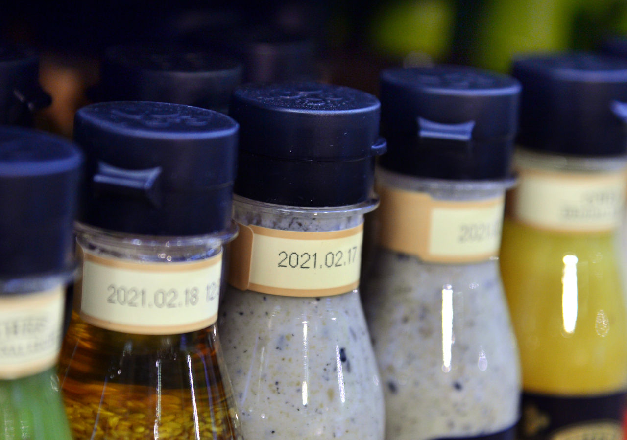 Salad dressings have sell-by dates marked on the bottles. (Park Hyun-koo/The Korea Herald)