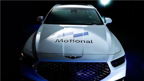 This file photo provided by Hyundai Motor shows a G90 flagship sedan with the logo of the Motional brand. (Hyundai Motor)