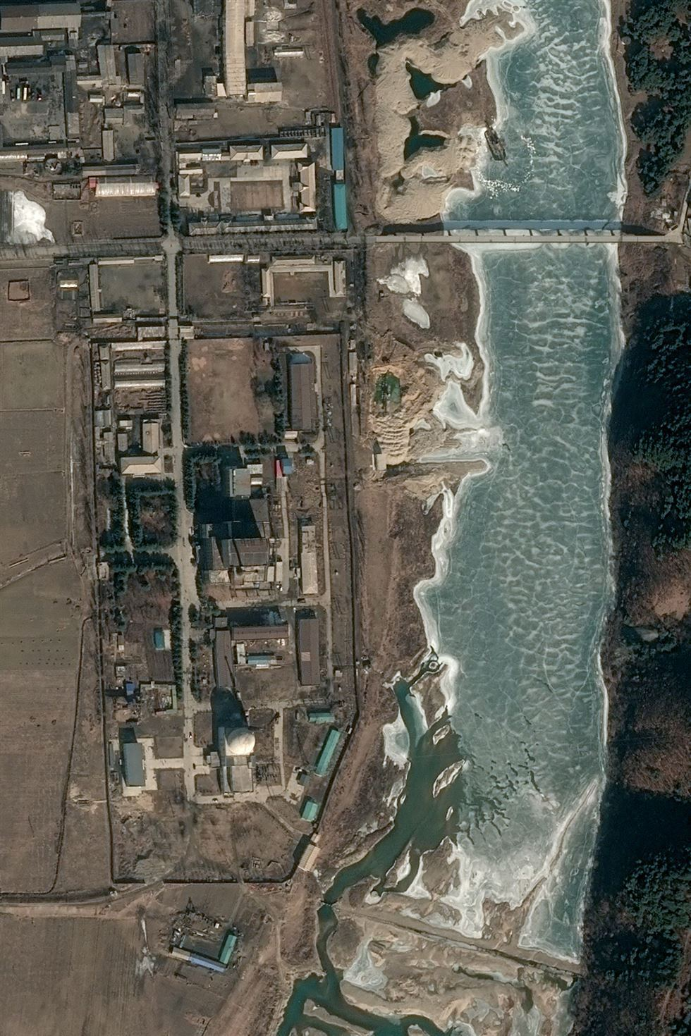 This handout satellite image taken on Feb. 21 and released to AFP by Pleiades, Cnes 2019, Distribution Airbus DS on Feb. 28 shows the 5 MWe reactor at North Korea's Yongbyon Nuclear Scientific Research Center showing no signs of activity. (AFP-Yonhap)