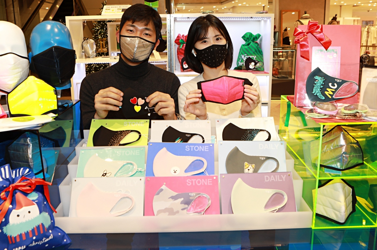 Models show off fashionable face masks at a Lotte Department Store in Seoul on Monday. (Yonhap)