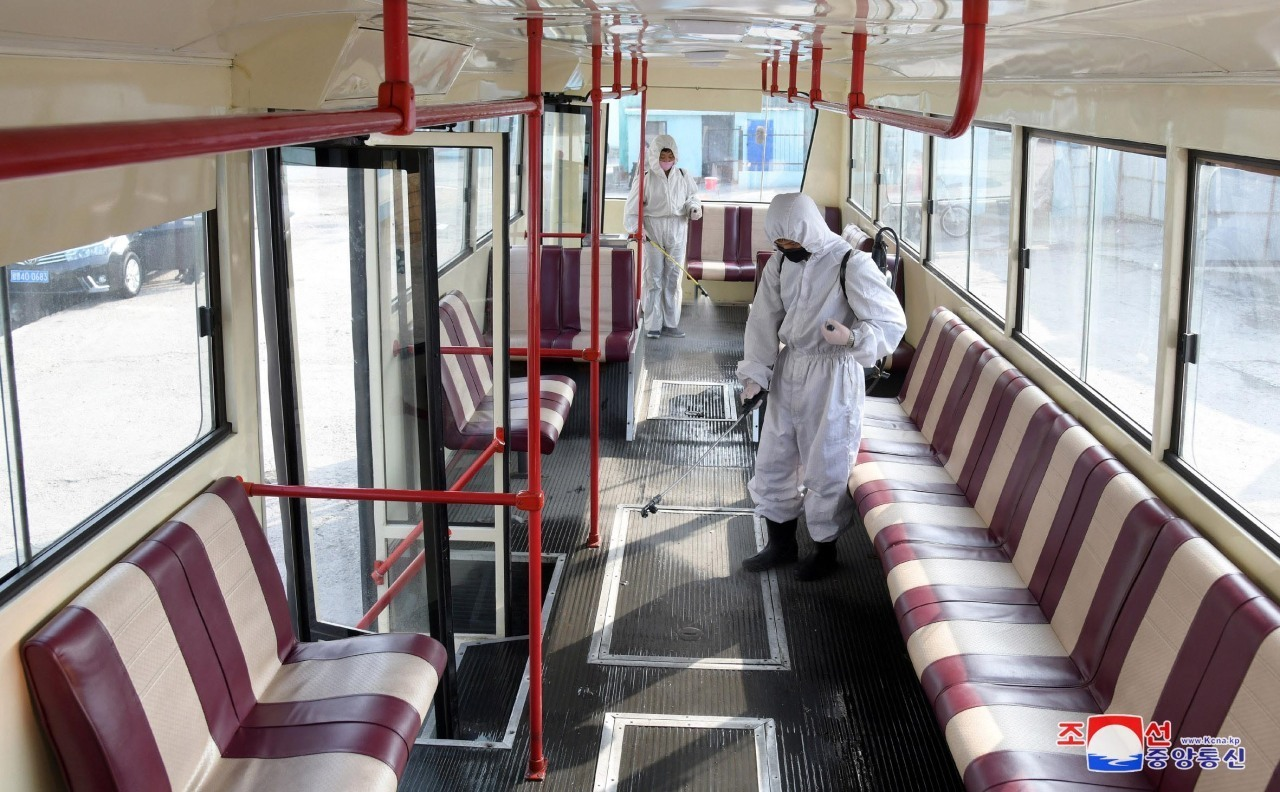 An official disinfects a bus amid the coronavirus pandemic. (KCNA-Yonhap)