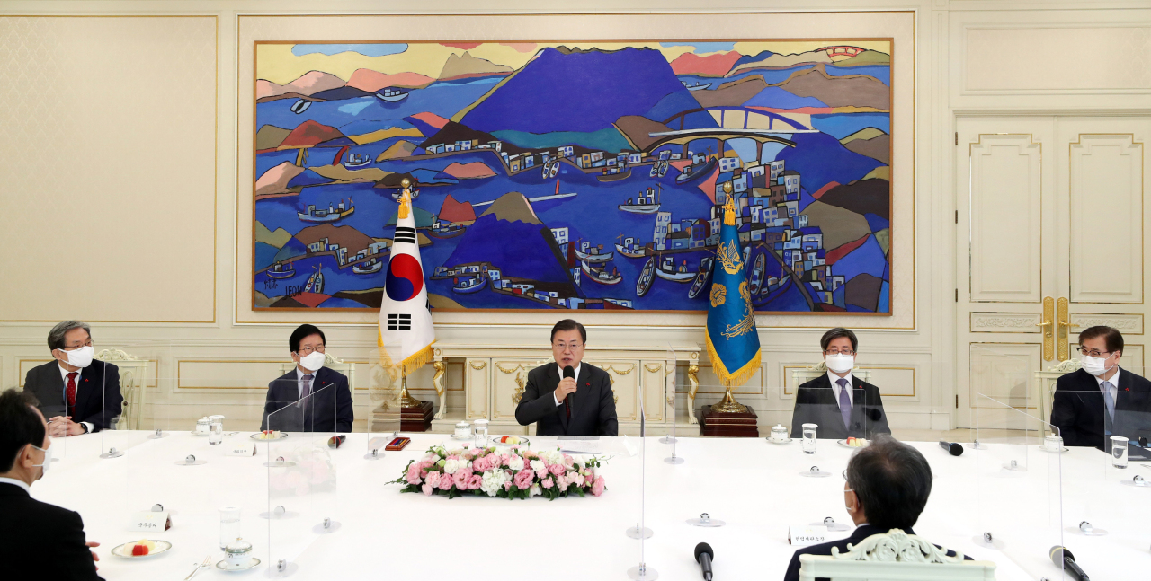 President Moon Jae-in (center) speaks Tuesday during a meeting with the five highest national leaders at the Blue House in Seoul. (Yonhap)