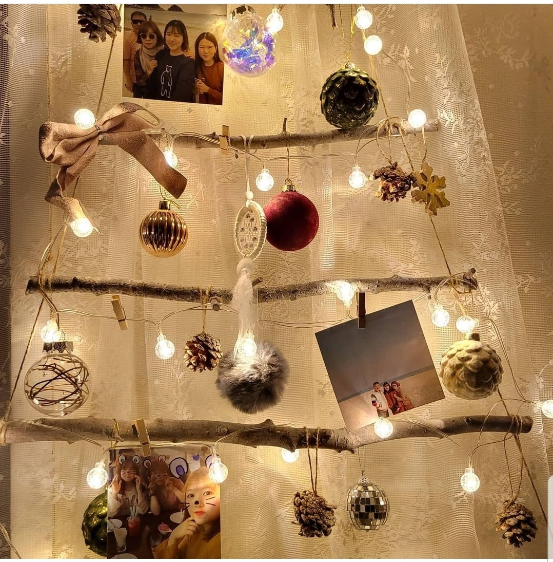 A wall Christmas tree is decorated with Kang family photos. (Courtesy of Kang Eun-mi)