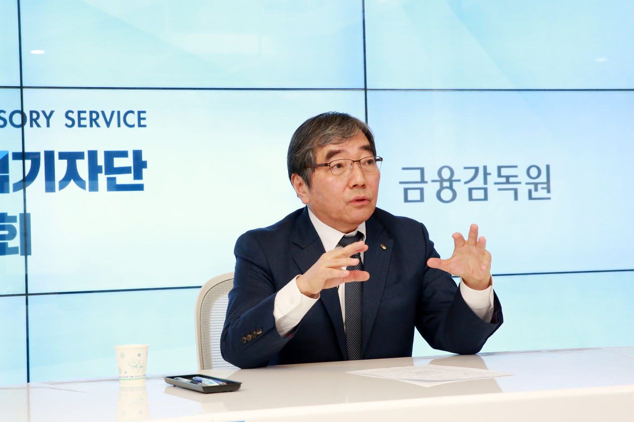 Financial Supervisory Service Gov. Yoon Suk-heun speaks at a press conference at the FSS building in Seoul, Wednesday, streamed online due to the COVID-19 resurgence. (Financial Supervisory Service)
