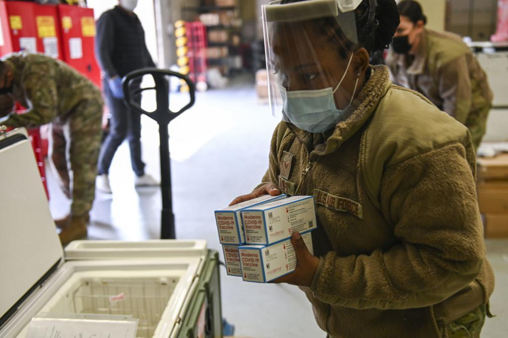 This photo provided by the US Forces Korea (USFK) on Monday, shows officials moving Moderna's COVID-19 vaccine delivered to Osan Air Base in Pyeongtaek, Gyeonggi Province. (US Forces Korea)