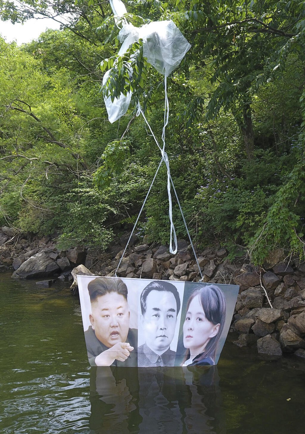 This photo, taken on June 23, 2020, shows a balloon containing anti-Pyongyang leaflets found at a mountain in Hongcheon, a town in South Korea's northeastern province of Gangwon. Tied to the balloon are photos of the North's leader Kim Jong-un, his late grandfather and the North's founder Kim Il-sung and his sister Kim Yo-jong. Fighters for a Free North Korea, a Seoul-based organization of North Korean defectors advocating for North Korean human rights, claimed it sent such balloons toward North Korea from the South Korean border town of Paju, north of Seoul, the previous day. (Yonhap)