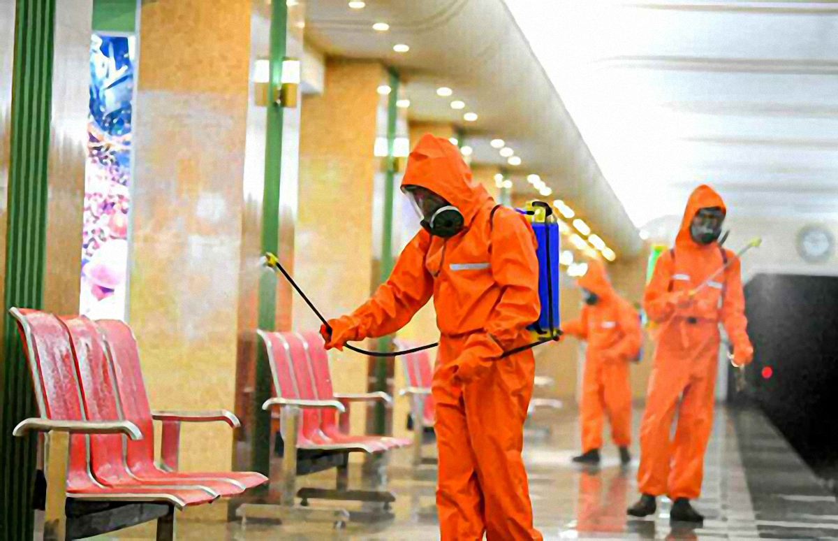 Health officials disinfect a subway station in Pyongyang in this photo from Rodong Sinmun on Aug. 1, 2020. (Rodong Sinmun-Yonhap)