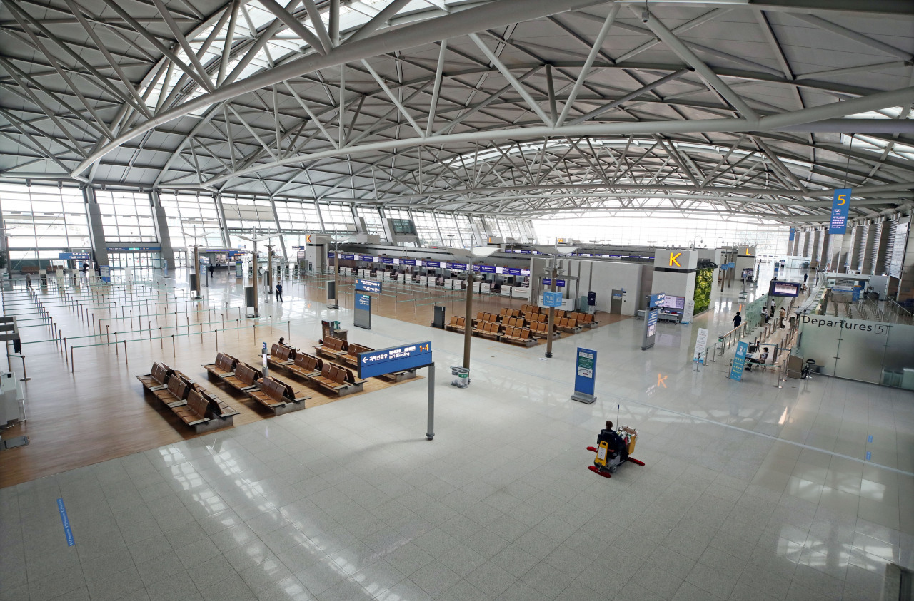 The departure floor at Incheon Airport stands empty in June due to the spread of COVID-19. (Yonhap)