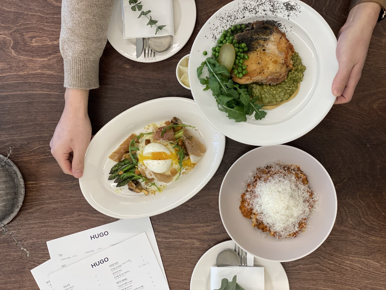 Hugo's Bourguignon Bolognese (far right), roasted herb chicken (center) and roasted asparagus and prosciutto (Photo credit: @hugo_dosan)