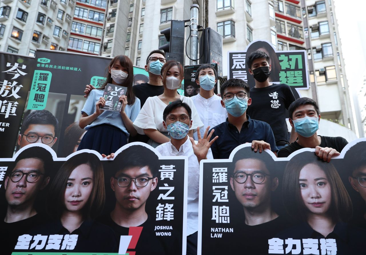 In this file picture taken on July 11, 2020, (Back row L-R) Agnes Chow, Anthony Wong, Tiffany Yuen, Denise Ho, Lester Shum, (front row L-R) Eddie Chu, Joshua Wong, and Gregory Wong pose while campaigning during a primary election in Hong Kong. (AFP-Yonhap)