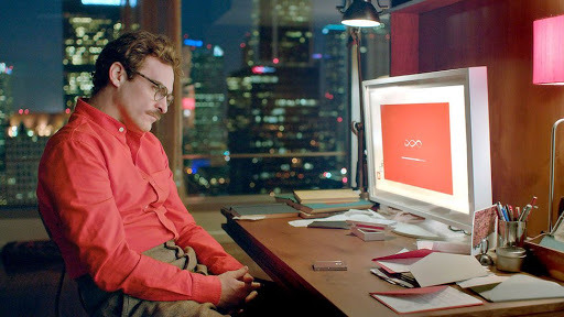 "Theodore, played by actor Joaquin Phoenix, sets up the AI ""Samantha"" for his desktop computer in the movie ""Her."" (Warner Bros. Pictures)"