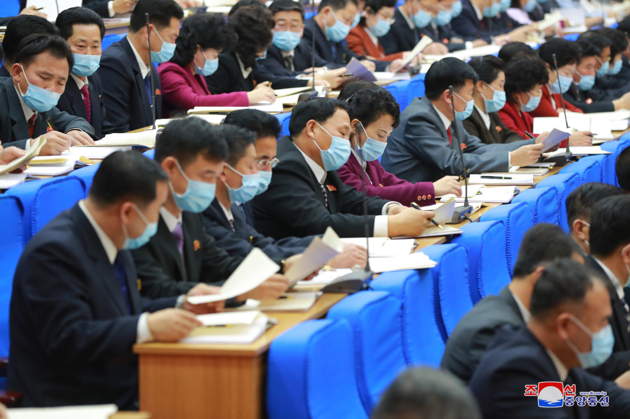 Delegates wear masks during the seventh day of the eighth congress of the ruling Workers' Party in Pyongyang on Monday, as they take part in inter-sector meetings to review a draft resolution on the policy goals rolled out by leader Kim Jong-un, in this photo released by the North's official Korean Central News Agency the next day. (KCNA-Yonhap)