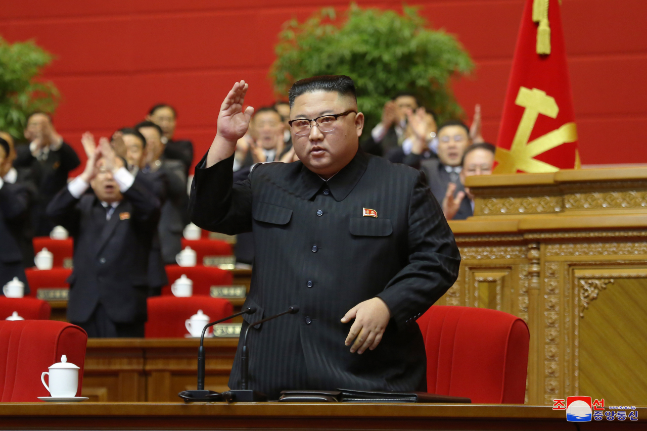 North Korean leader Kim Jong-un waves to officials attending the final day of the eighth congress of the ruling Workers` Party in Pyongyang on Tuesday. (KCNA-Yonhap)