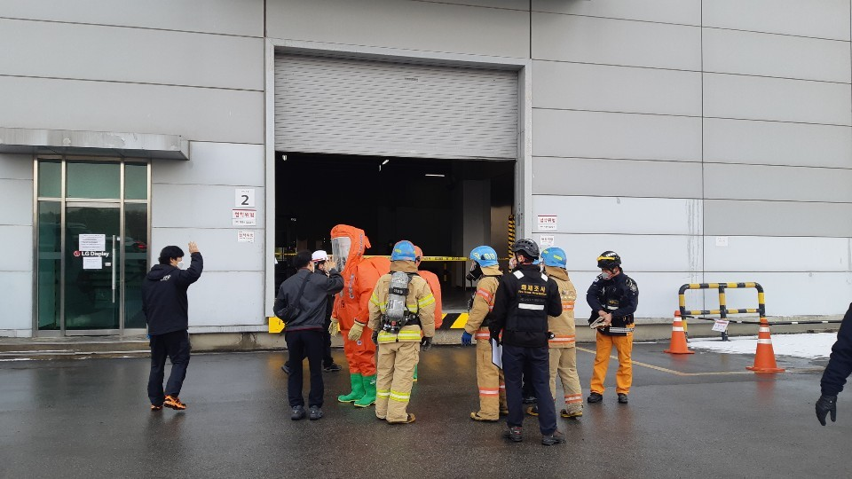 This photo provided by Paju Fire Station shows rescue officials working at LG Display Co.'s plant in Paju, north of Seoul, to handle a toxic chemical leak at the factory. (Paju Fire Station )