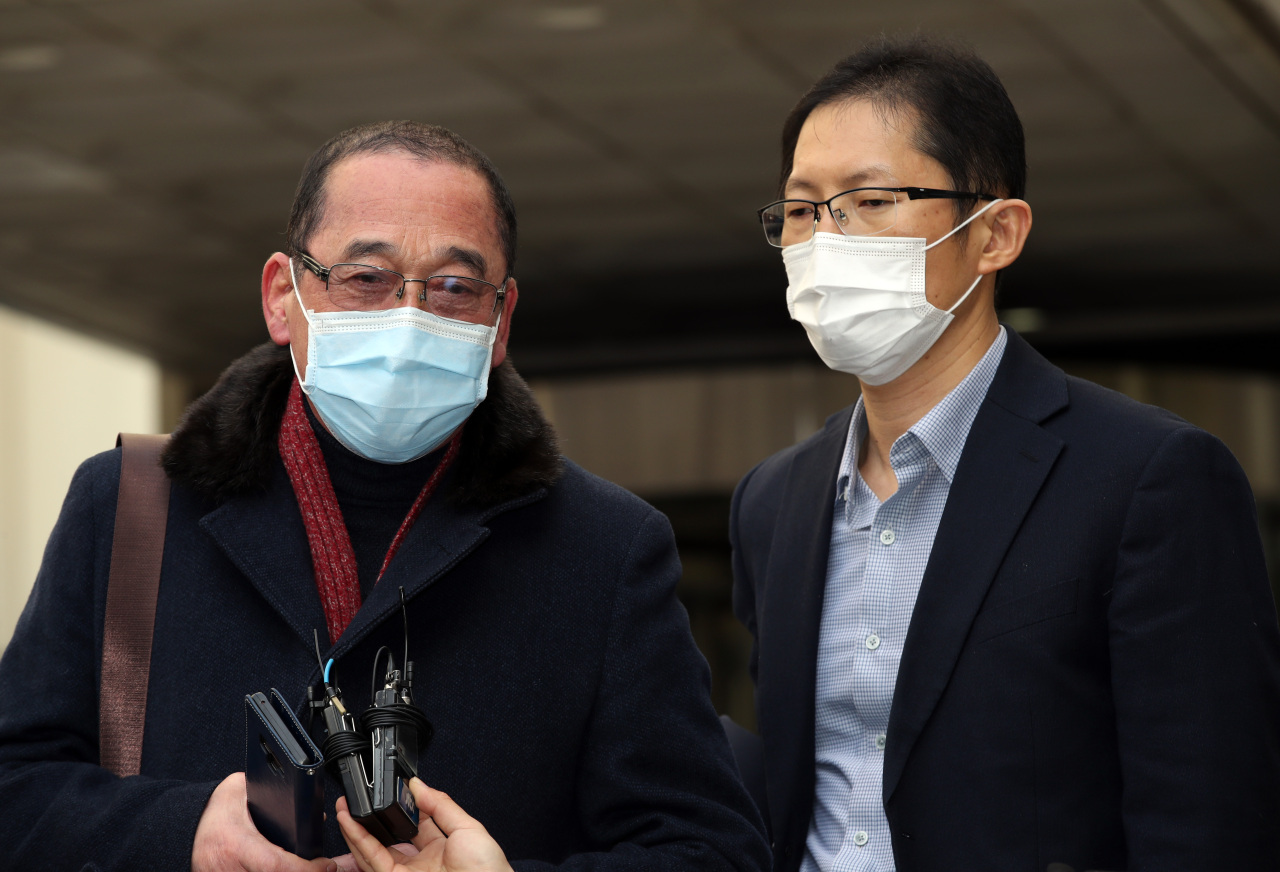 Legal representatives of a man surnamed Choi, who was wrongfully convicted ofmurder in 2000, speak with reportersat the SeoulCentral District Court on Wednesday.(Yonhap)