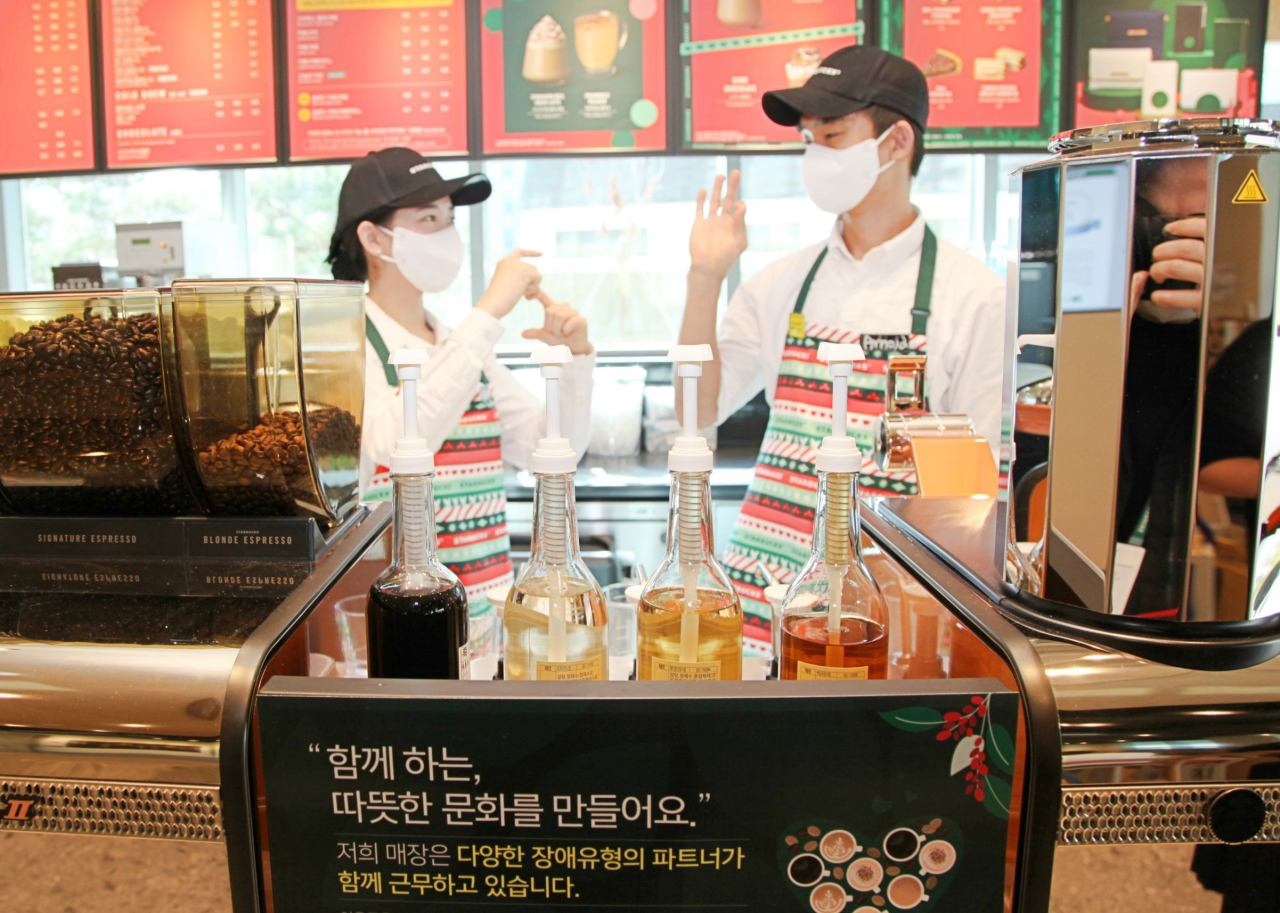 Starbucks Coffee Korea staffs pose at the coffee outlet in Seoul National University Dental Hospital. (Starbucks Coffee Korea)