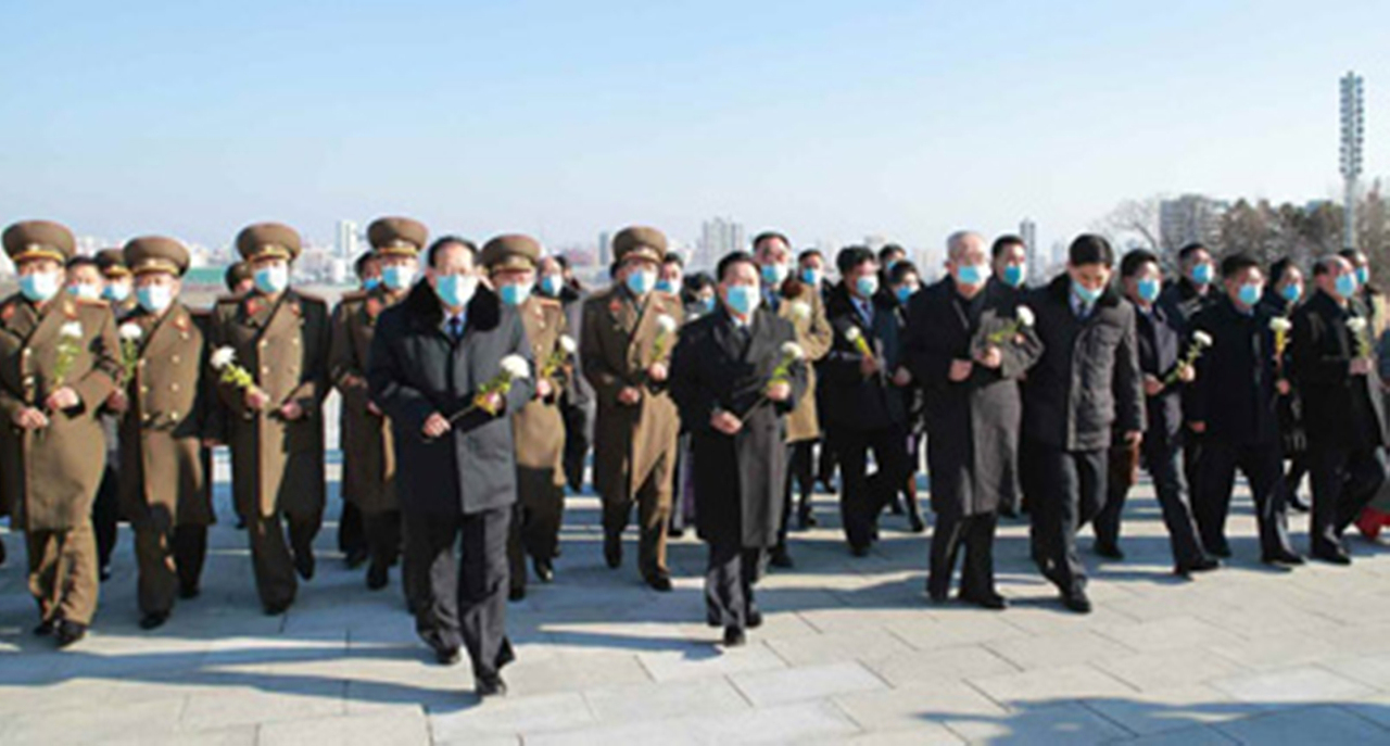 This image, captured from North Korea's Rodong Sinmun newspaper on Sunday, shows Choe Ryong-hae, the president of the Presidium of the Supreme People's Assembly, and parliamentary representatives walking toward statues of former North Korean leaders in Pyongyang to offer flowers. (Rodong Sinmun)