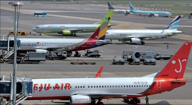 Planes from low-cost carriers are on the ground at Gimpo Airport in Seoul. (Yonhap)